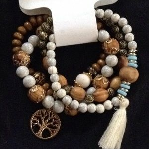 Set of 4 beaded bracelets features Tree of Life